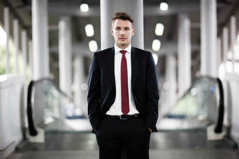 A casual corporate headshot of solicitor Daniel at the airport in central London.