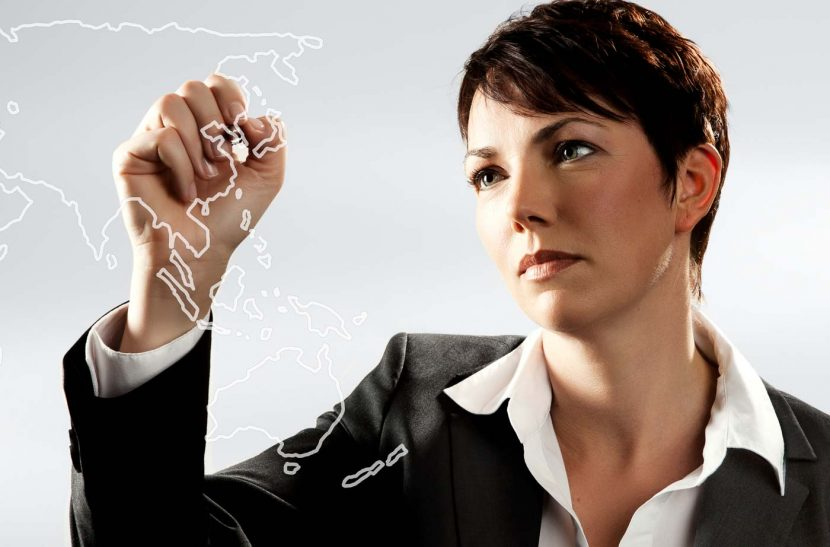 A corporate headshot of a woman drawing a chart on an imaginary wall. Shot for HSBC homepage.